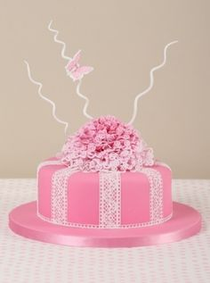 This pretty-in-pink celebration cake by Tessa Whitehouse is decorated with intricate edible lace.
