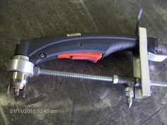 Plasma Circle Cutter - Homemade plasma circle cutter fabricated from aluminum channel, threaded rod, and hardware.