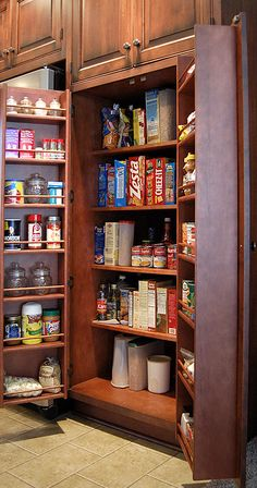 """Loads of info about types of pantry design includint the classic """"bat-wing"""" reach-in pantry cabinet provides convenient and flexible storage in a small space.  Large items are stored inside the cabinet, cans, bottles and other smaller items in the doors."""
