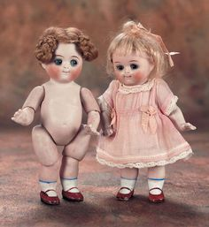German All-Bisque Googly,111,with Jointed Elbows and Knees in Pink Dress - circa 1915