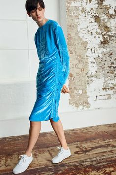 Invest in an extra-luxe feel with this crushed velvet dress by Boutique in baby blue. Adorned with ruched detailing to the side and front, it is cut below the knee – perfect for both parties and formal occasions. Made in London.