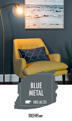 Get inspired by the dark and moody hue of Behr Paint in Blue Metal. This deep shade of blue-gray is almost neutral, making it easy to coordinate with other colors. Use bright accent colors, like this yellow chair, to lighten up this bold wall color. Click below for more home decor inspiration.