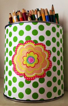 Paper-covered can for colored pencils.