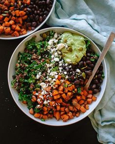 Healthy kale and quinoa power salad with spicy sweet potato, black beans and creamy avocado sauce. This gluten-free salad packs well for lunch, too!