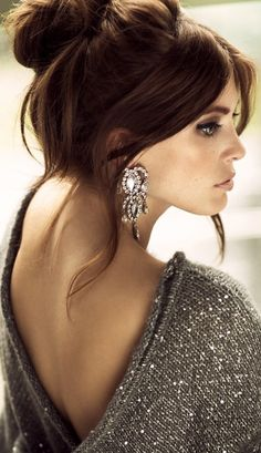 Love the big earrings with messy, upswept hair and a slouchy sweater.