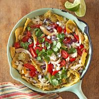 Cilantro-Chicken Chilaquiles with Crumbled Queso Fresco  ~~>Bring this colorful Mexican dish to your next potluck and be prepared for compliments! Baked tortillas serve as a base for chicken, cheese, tomatoes, cilantro, and red onion. Garnish with sour cream if you like.