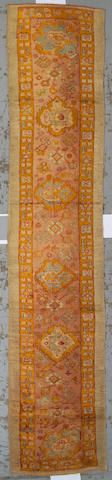 Oushak runner  West Anatolia,  late 19th century  size approximately 3ft. x 14ft. 6in.