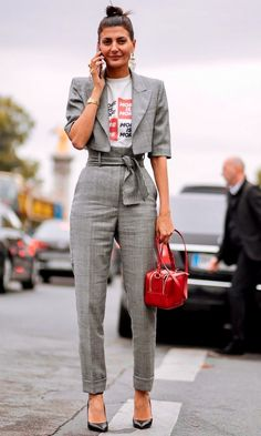 Love when women wear suits. the copped jacket layered with a graphic tee is a fun way to wear the suit.