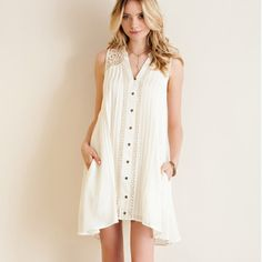 "Buy 1 Get 1 50% Gorgeous w/Pockets Ivory Dress Solid button down dress w/ pin tuck pleating detail, crochet paneling on front & lace paneling on shoulders & back of dress. Wear as dress or tunic! Looks gorgeous with a dress extender shown in last photo. Non-sheer. Fully lined. Lightweight. 35"" from top to bottom, front of dress about 1.5 higher taken from Small. Great Quality. So comfy! Dresses Midi"