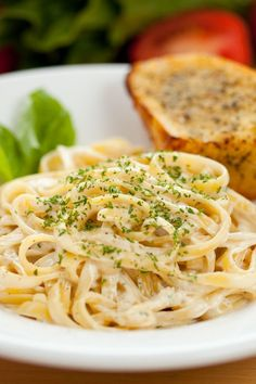 Recipe including course(s): Entrée; and ingredients: black pepper, butter, cream cheese, fettuccine, flour, garlic cloves, Italian parsley, non-fat milk, parmesan cheese