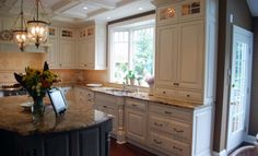 Love this traditional kitchen with marble countertops and white clean cabinets all over the place.