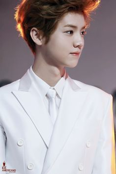 Luhan. That white suit though. Imagine spilling something down that ah that would be irritating.