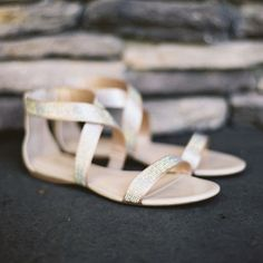 Brides.com: . Striking Gold Sandals. Match these modern metallic sandals with a one-shoulder gown and eye-popping nail polish. See more gold wedding accessories.