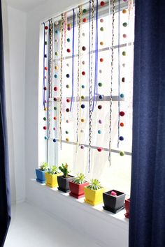 Simple yarn and felt window hanging for spring plus painted pots of succulents Cute and colorful living room decor