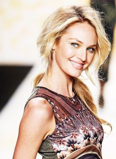 Candice Swanepoel's flawless complexion and voluminous curls