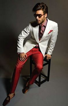 Great white jacket accented with a red plaid shirt. The look is all pulled together with the red pant. Love it!