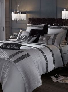 Kylie Minogue Safia Silver sequin bedding range Inspired by Kylie's glamour and sophistication this beautiful Safia bed linen range encapsulates glamour. A luxury silver colour with shimmering panels of subtle silver sequins . See more details at BHS Glam Bedroom, Bedroom Sets, Home Bedroom, Modern Bedroom, Bedding Sets, Bedroom Decor, Sequin Bedding, Silver Bedding, Black And Silver Bedroom