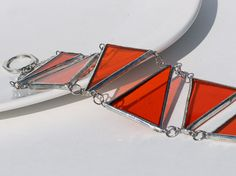 Stained Glass Jewelry Bracelet Tangerine Tango by LAGlass (no longer available). Terrific designer, very responsive to inquiries. Wish I'd bought it when I first saw it.