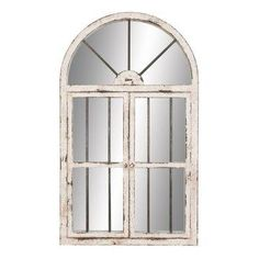 Window-inspired wood frame in distressed white finish.