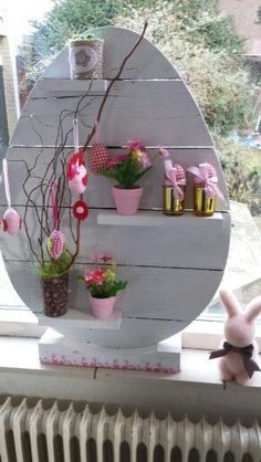 Fill the egg - Easter Egg-A-Palooza foyer display: attach a wooden box to the back for candy collection.