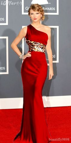 Love the leopard offset at the waist of the one shoulder Red Gown