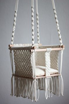 Handmade macramé baby swing is a product