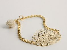 Bridal Bracelet - Gold Lace Bracelet - Wedding Jewelry - Bridal Jewelry - Bridesmaid Jewelry - Romantic Jewelry - Elegant  24k gold plated brass chain bracelet with filigree element and an Ivory color flower in the end of the chain.  It is a romantic inspired retro-piece, that completes your look with a delicate, yet fashionable and timeless touch.  Will upgrade any bride or bridesmaid look! The bracelet size is adjustable since it can be closed in each link of the chain.  $29.00