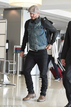 Where to now? David Beckham looked rather handsome as he arrived at JFK airport on Sunday following a three day trip