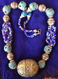 Moroccan Berber Necklace with Old Enamel Eggbead, Turquoise, Silver & Blue glassbeads Now in webshop: https://www.etsy.com/listing/222244794/moroccan-berber-necklace-with-old-enamel BY INEKE HEMMINGA