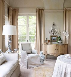 Layered rugs, trimmed curtains, upholstery- Gail Plechaty