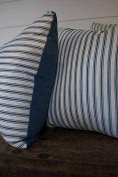 A handmade pillow made using salvaged mattress ticking an down feather insert. Has a heavy vintage zipper on one side of the pillowcase making it easy to remove for cleaning. This fabric is vintage an                                                                                                                                                                                 More