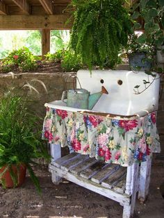 Old double enamelled sink as free standing potting or garden utility table