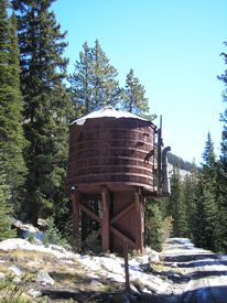 Once the highest railroad tunnel in the world, the Alpine Tunnel was the first tunnel to be built through the Continental Divide. Ho Trains, Model Trains, Ghost Towns Of America, Colorado Mountains, Rocky Mountains, Railroad History, Train Times, Water Storage, Water Tower