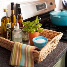 storage solutions using baskets: Kitchen Counter Basket - Use a shallow basket to organize cooking oils and spices. Line the bottom of the basket with a metal cookie sheet to making cleaning up inevitable spills easier. Kitchen Organization, Organization Hacks, Kitchen Storage, Basket Organization, Organization Station, Kitchen Dining, Kitchen Decor, Kitchen Counters, Kitchen Styling