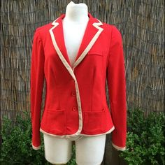 "🎉HP🎉 Flattering designer jacket, stretchy! This is an incredibly comfortable soft red jacket with khaki trim. The material is 74% polyester 23% viscose 3% spandex.  Jacket is stretchy and will move with your figure because of the spandex.  Cute red buttons on sleeves.  Kakhi trim around bottom of jacket.  Fashionable slit in back for increased movement.   This is a truly superb jacket.   I'd keep it but it doesn't fit me.  It's in excellent like new condition.  Length is 26"". Chest is 18""…"