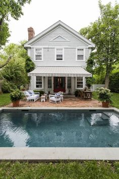 | A Summer Dream House in Sag Harbor | A The couple installed a striped awning in the back of the house to add a touch of old-school character.