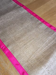 Check out this item in my Etsy shop https://www.etsy.com/uk/listing/274865474/hot-pink-grosgrain-ribbon-edged-hessian
