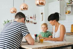 Family of Three at Home - Caucasian Parents Painting With Small Blond Boy at Kitchen Table by VISUALSPECTRUM for Stocksy United