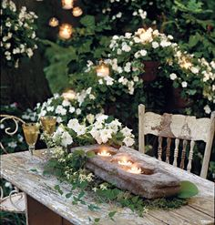 White impatient flowers surround a weathered outdoor table