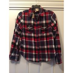 Passport Flannel Button-down Shirt Passport Flannel Button-down Shirt. Can be worn as long-sleeved or cuffed and buttoned and worn as three-quarter length! Red, white, navy blue with floral trim on collar & two pockets in the front. SIZE: Woman's Large Passport Tops Button Down Shirts