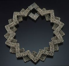"""Sterling Lotus"" Necklace, 2006   Sterling silver beads and clasps. 11"" diam. x 3/4"" h. Collection of Judith Bard  Copyright Valerie Hector 2006; all rights reserved.  Photo: Sanders Visual Images."