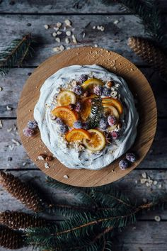christmas pavlova with sugared cranberries and orange