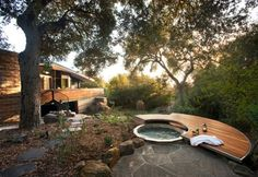 calming backyard with modern hot tub and patio