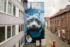 While we last heard from him last May in Roeselare, Belgium, Bart Smeets aka Smates is now in Mechelen where he just wrapped up this impressive and massive mural.