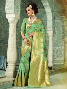 8e4cd68ebbae7 Fashion and trend will be at the peak of your beauty once you dresses this  green handloom silk traditional saree. The ethnic weaving work for the  clothing ...