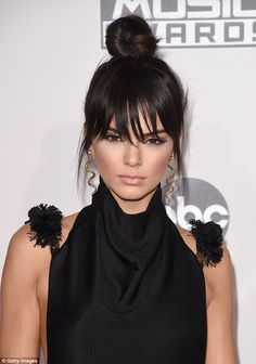 New 'do: The 20-year-old debuted her new haircut featuring bangs on the red carpet ...