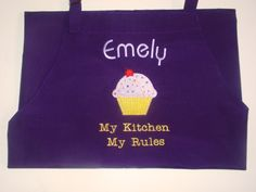 Adult baking apron decorated with machine embroidered design - you choose the colors - personalized with a name and a short phrase.