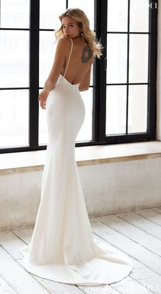 Simple mermaid wedding dress with contemporary silhouette, open back and spaghetti straps for the minimalist bride Sparkly sexy contemporary bridal gown style | Eva Lendel Wedding Dresses 2021- Less is More Collection -Daniel - Belle The Magazine See more gorgeous bridal gowns by clicking on the photo