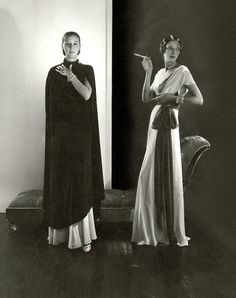 Marion Morehouse wearing a black cape and Ruth Covell wearing a long white crepe dress with a dark sash around her waist by Vionnet, photo by Edward Steichen, ca. 1932