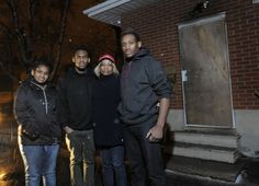 Elizabeth Burrell (second from right) with her children Shayenne McKenzie (left), 13, Tre Nicholson, 16, and Jerelle Vaughan, 18, visit their burned home in Kitchener on Thursday.
